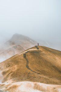 Woman climbing mountain trail