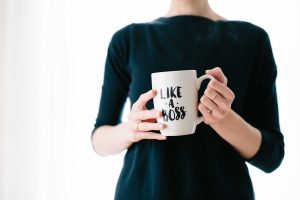 "Woman holding mug that says ""Like a boss"""