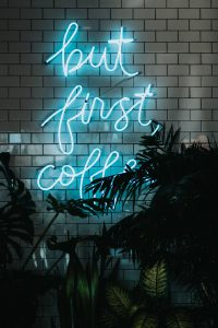 "Neon sign that says ""but first, coffee"""